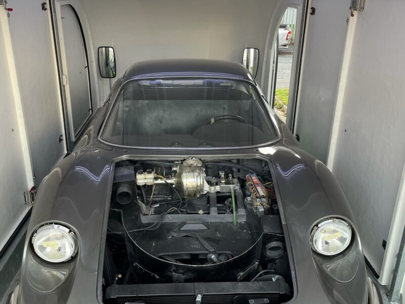 Ferrari Dino enclosed vehicle transport to trimmers